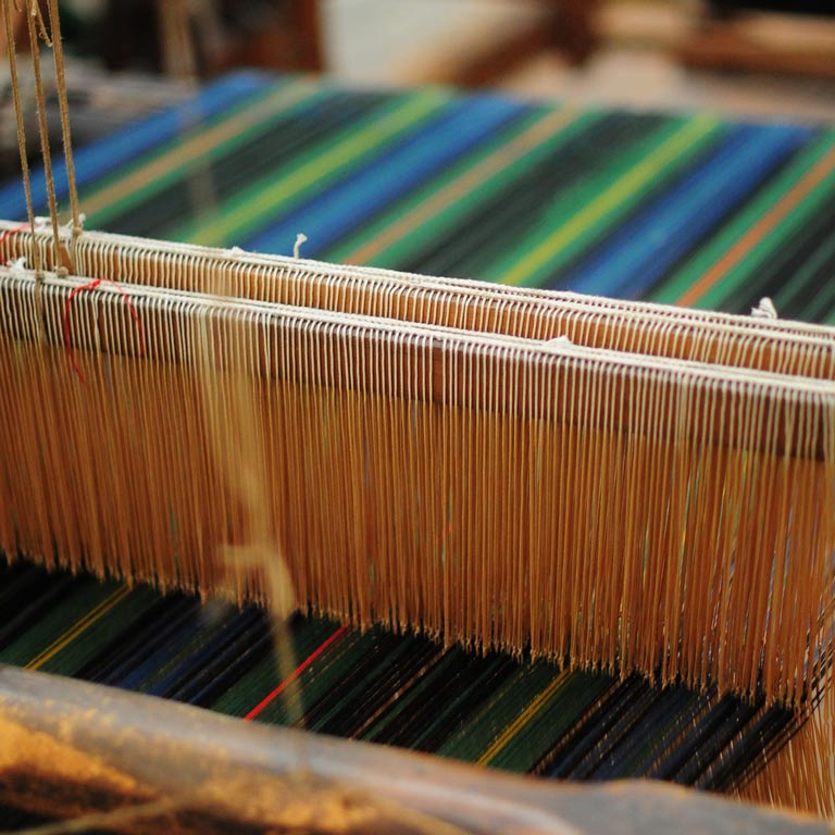 Close up of a loom creating a colorful textile
