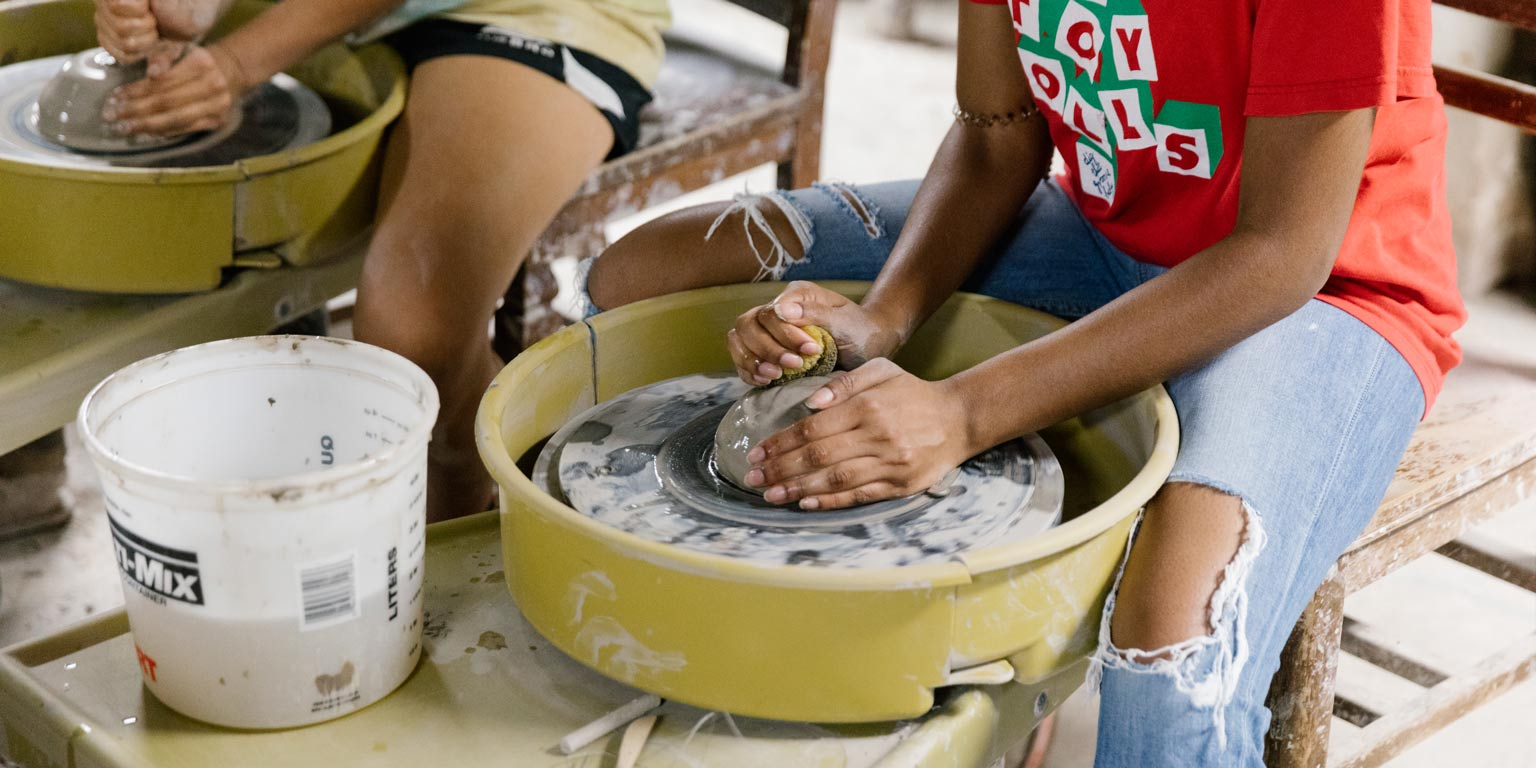 Two students making pottery