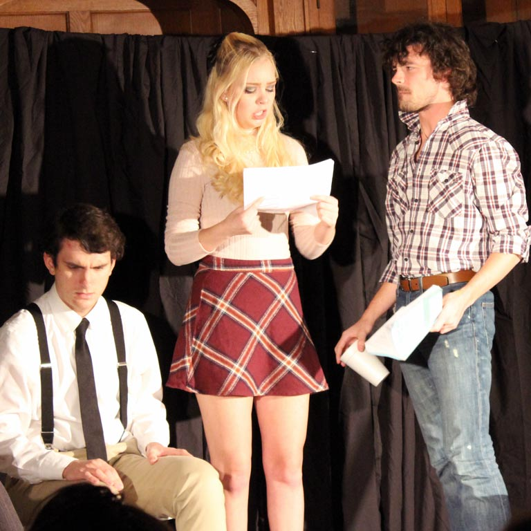 Three students perform a read-through of a script