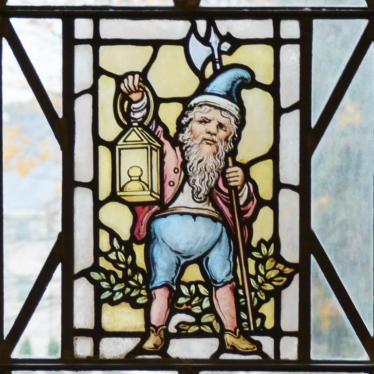 Stain glass rendering of gnome holding a lantern