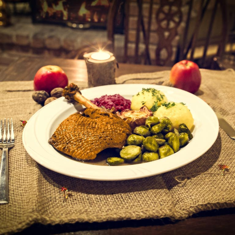 Rustic place setting with dinner ready on the plate